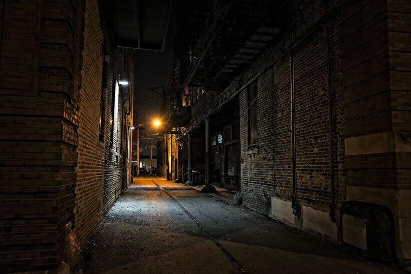 Dark urban city alley at night