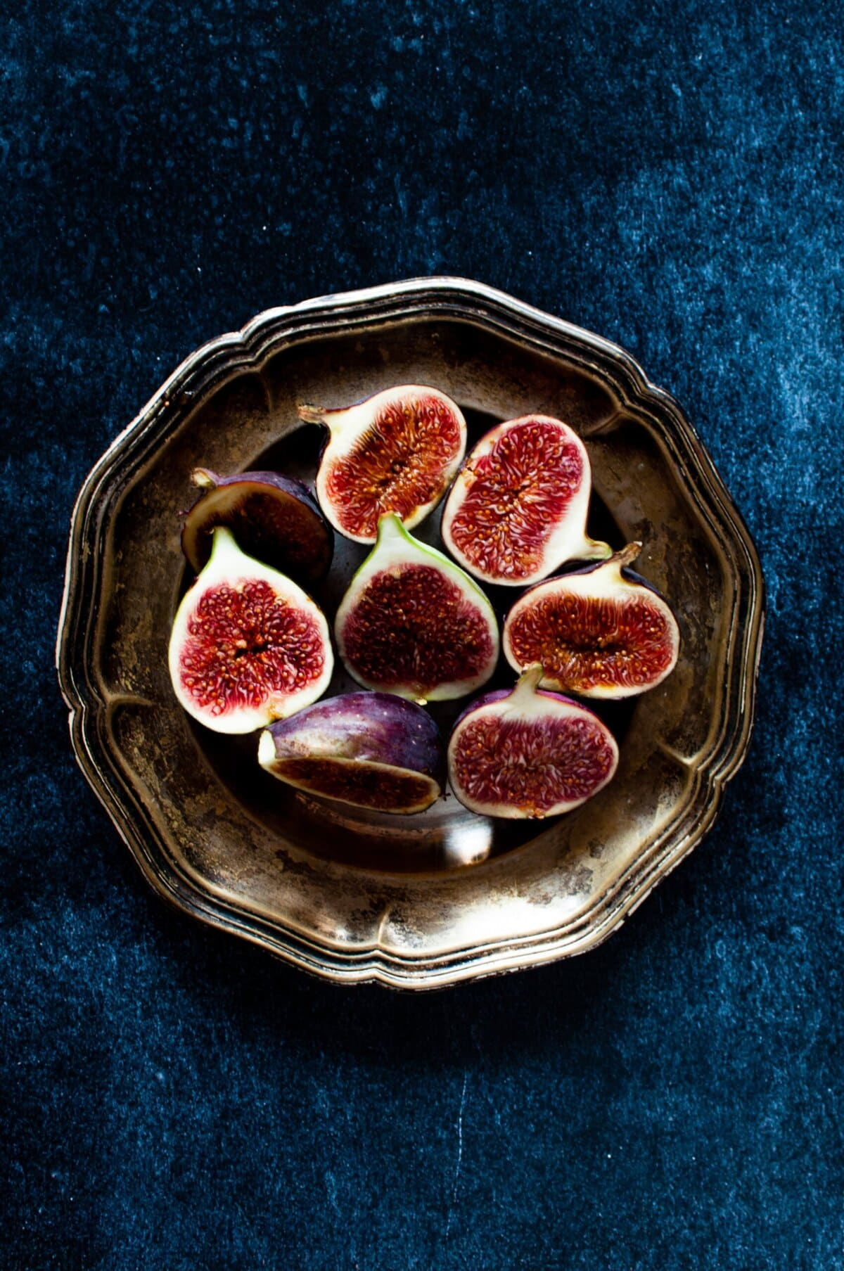 red fruits in brown plate