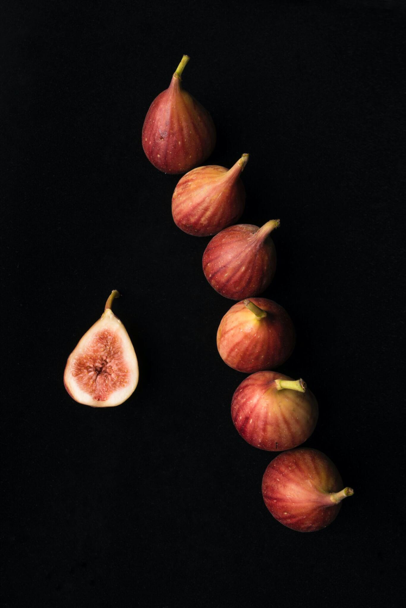 six onions on black surface