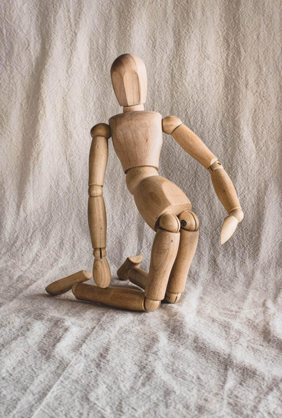 brown wooden human figure