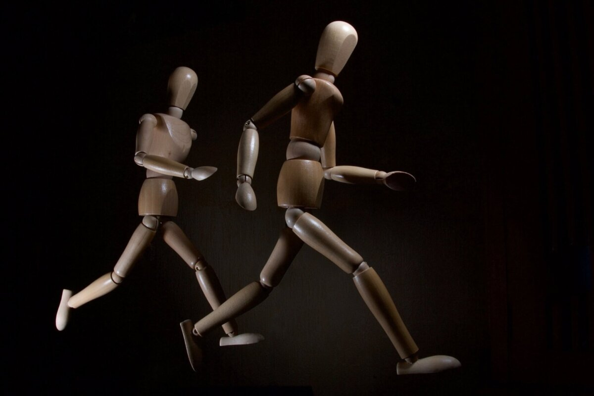 two running brown wooden stickmen