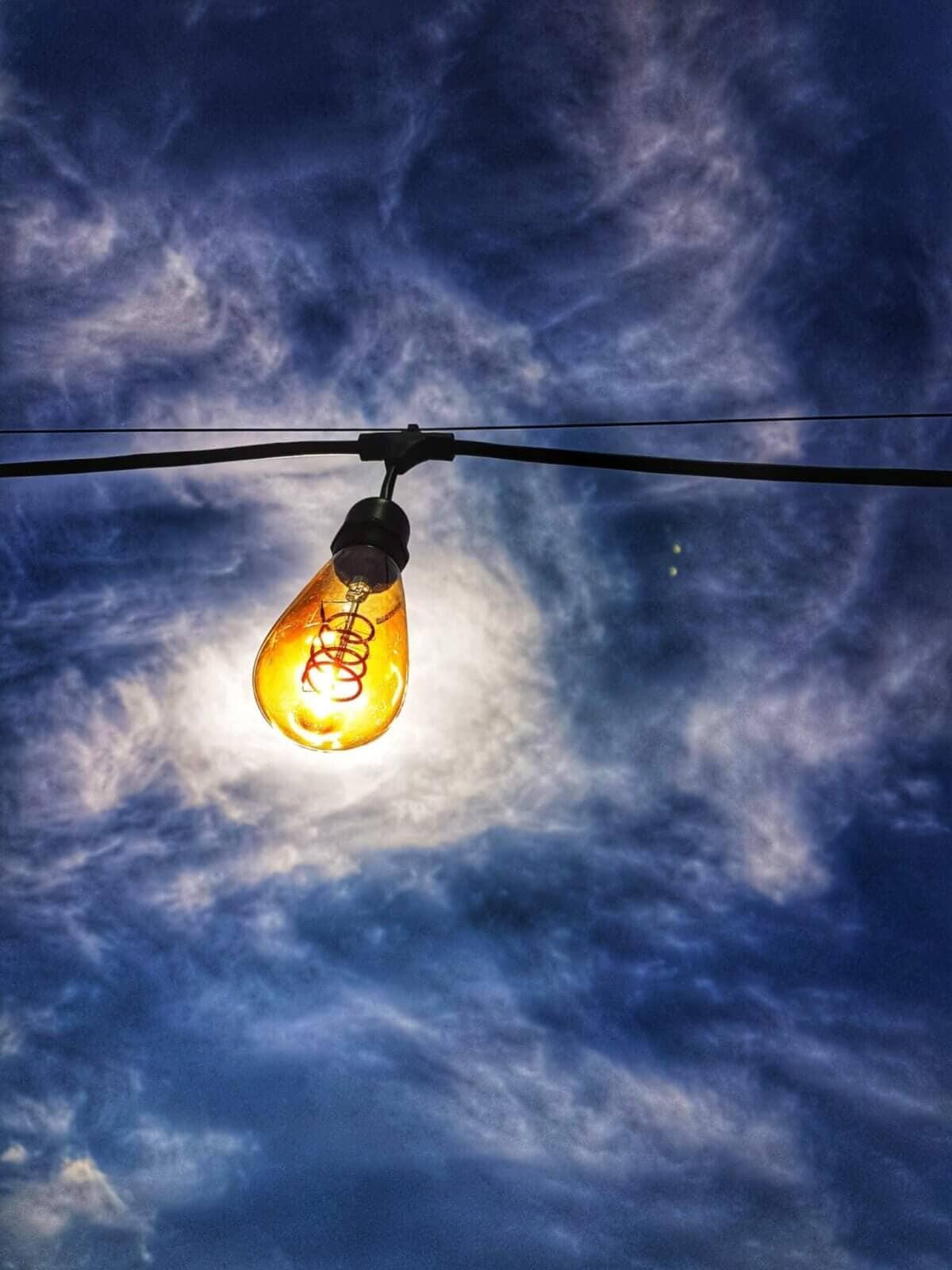 yellow light bulb under blue sky